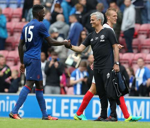 Axel Tuanzebe with Jose Mourinho after the game against Wigan