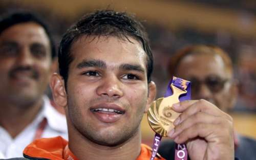 DELHI, INDIA - OCTOBER 09: Narsingh Pancham Yadav of India celebrates after winning a gold medal in the men's 74KG Wrestling at IG Sports Complex during day six of the Delhi 2010 Commonwealth Games on October 9, 2010 in Delhi, India. (Photo by Ian Walton/Getty Images)