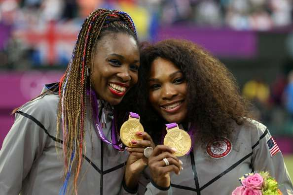 LONDON, ENGLAND - AUGUST 05:  Gold medalists Serena Williams of the United States and Venus Williams of the United States celebrate during the medal ceremony for the Women