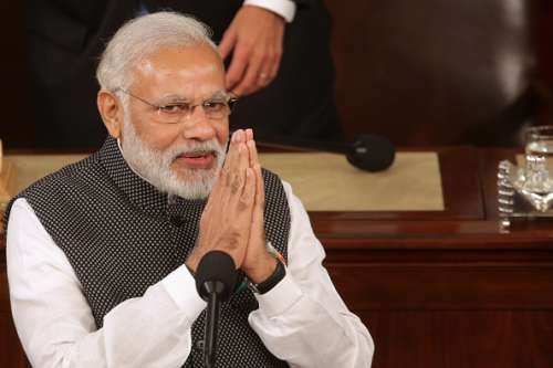 WASHINGTON, DC - JUNE 08:  Indian Prime Minister Narendra Modi salutes while addressing a joint meeting of the U.S. Congress in the House Chamber of the U.S. Capitol June 8, 2016 in Washington, DC. Modi met with President Barack Obama for bilateral meetings on Tuesday.  (Photo by Chip Somodevilla/Getty Images)