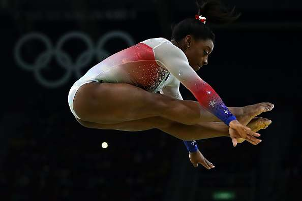 RIO DE JANEIRO, BRAZIL - AUGUST 17:  Simone Biles of the United States performs on the beam during the Gymnastics Rio Gala on Day 12 of the 2016 Rio Olympic Games on August 17, 2016 in Rio de Janeiro, Brazil.  (Photo by Clive Brunskill/Getty Images)