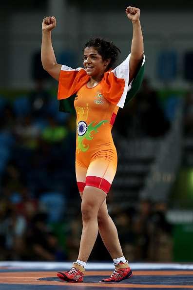 RIO DE JANEIRO, BRAZIL - AUGUST 17:  Sakshi Malik of India is declared the winner against Aisuluu Tynybekova of Kyrgyzstan during the Women