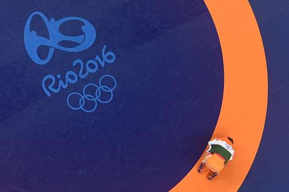 RIO DE JANEIRO, BRAZIL - AUGUST 17:  (L-R) Silver medalist Valeriia Koblova Zholobova of Russia, gold medalist Kaori Icho of Japan, bronze medalist Marwa Amri of Tunisia and bronze medalist Sakshi Malik of India celebrate during the medal ceremony after the Women