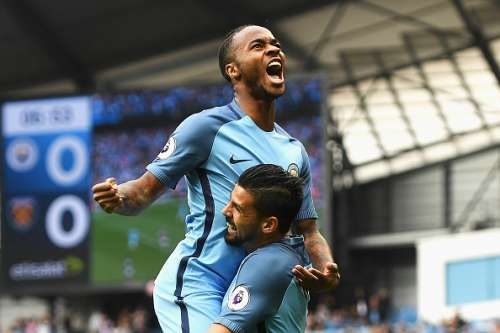 MANCHESTER, ENGLAND - AUGUST 28:  Raheem Sterling of Manchester City celebrates scoring the opening goal with Nolito during the Premier League match between Manchester City and West Ham United at Etihad Stadium on August 28, 2016 in Manchester, England.  (Photo by Gareth Copley/Getty Images)