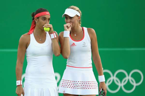 Caroline Garcia (left) and Kristina Mladenovic of France during their doubles match Day 1 of the Rio 2016 Olympic Games at the Olympic Tennis Centre in Rio de Janeiro, Brazil on Saturday