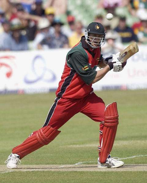 CANTERBURY, ENGLAND - JUNE 29:  Douglas Marillier of Zimbabwe hits out during the third match of the NatWest one day triangular series between South Africa and Zimbabwe at Canterbury Cricket Ground on June 29, 2003 in London. (Photo by Paul Gilham/Getty Images)