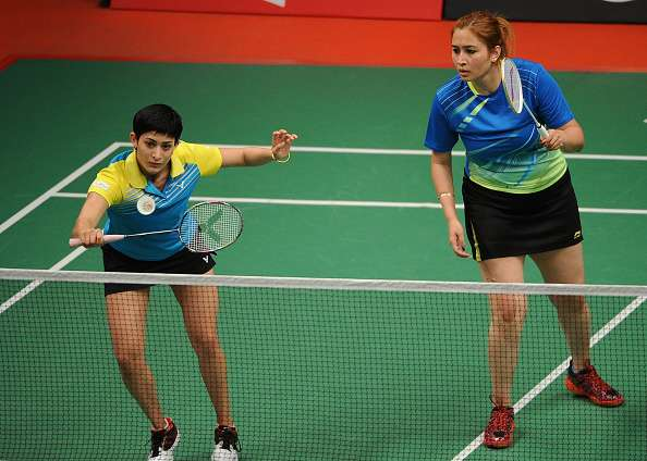 JAKARTA, INDONESIA - AUGUST 12:  Jwala Gutta and Ashwini Ponnappa of India compete against Hsieh Pei Chen and Wu Ti Jung of Taipei in the 2015 Total BWF World Championship at Istora Senayan on August 12, 2015 in Jakarta, Indonesia.  (Photo by Robertus Pudyanto/Getty Images)