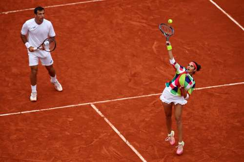 PARIS, FRANCE - JUNE 03:  Sania Mirza of India and Ivan Dodig of Croatia in action during the Mixed Doubles final match against Martina Hingis of Switzerland and Leander Paes of India on day thirteen of the 2016 French Open at Roland Garros on June 3, 2016 in Paris, France.  (Photo by Clive Brunskill/Getty Images)