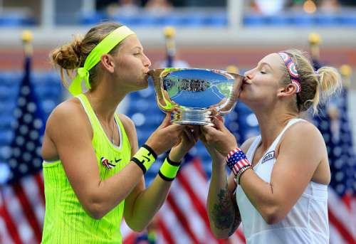 NEW YORK, NY - SEPTEMBER 11:  Bethanie Mattek-Sands (R) of the United States and Lucie Safarova of the Czech Republic celebrate with the trophy after defeating Caroline Garcia and Kristina Mladenovic of France with a score of 2-6, 7-6, 6-4 in their Women's Doubles Final Match on Day Fourteen of the 2016 US Open at the USTA Billie Jean King National Tennis Center on September 11, 2016 in the Queens borough of New York City.  (Photo by Chris Trotman/Getty Images for USTA)