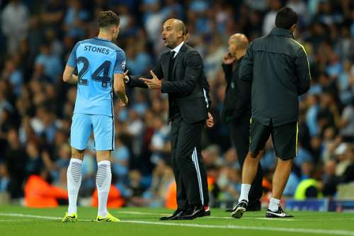 MANCHESTER, ENGLAND - SEPTEMBER 14:  John Stones of Manchester City speaks to his manager, Josep Guardiola ring the UEFA Champions League match between Manchester City FC and VfL Borussia Moenchengladbach at Etihad Stadium on September 14, 2016 in Manchester, England.  (Photo by Richard Heathcote/Getty Images)