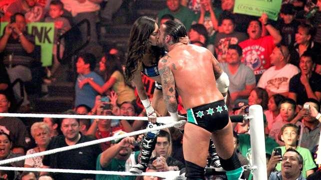 AJ Lee kisses her future real life husband CM Punk