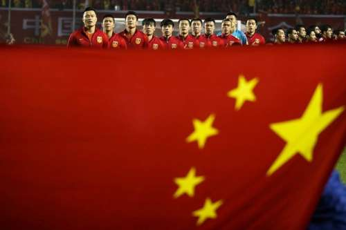 Football Soccer - China v Syria - 2018 World Cup Qualifying Asia Zone - Round 3 Group A - Xi'an, China - 6/10/16 - Team China listen to national anthem behind a Chinese national flag ahead of the match. REUTERS/Stringer