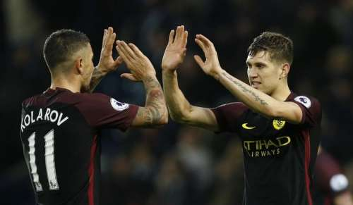 Britain Football Soccer - West Bromwich Albion v Manchester City - Premier League - The Hawthorns - 29/10/16 Manchester City's Aleksandar Kolarov and John Stones celebrate after the match Action Images via Reuters / Andrew Boyers Livepic