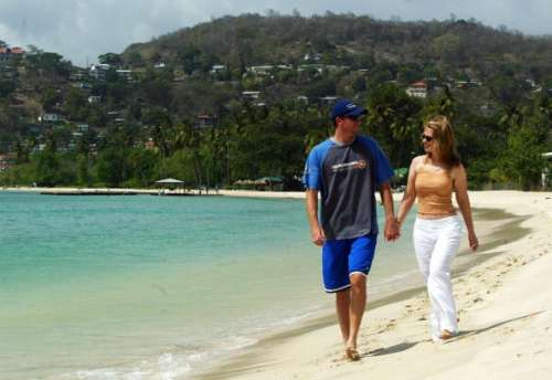 ST. GEORGE'S, GRENADA - MAY 29:  Glenn McGrath of Australia with wife Jane on May 29, 2003 on the beach in St. George's, Grenada.  (Photo by Hamish Blair/Getty Images)