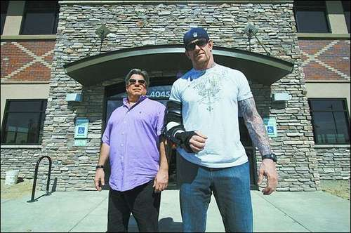 The Undertaker with Scott Everhart posing in front of the 'Calahart'