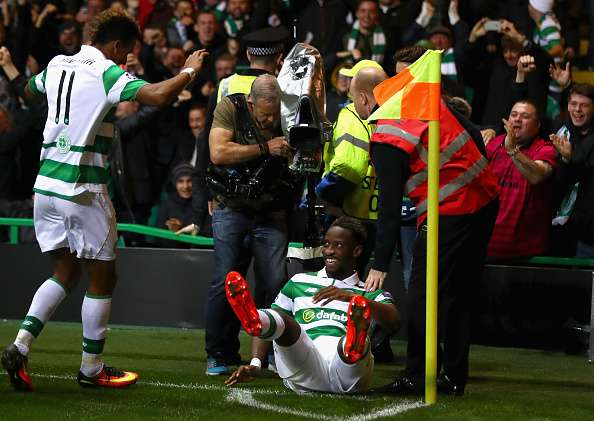 GLASGOW, SCOTLAND - SEPTEMBER 28:  Moussa Dembele of Celtic celebrates with team-mates after scoring his team