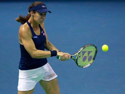 WUHAN, CHINA - SEPTEMBER 29:  Martina Hingis of Switzerland and CoCo Vandeweghe of United States (not in picture) in action against Aleksandra Krunic of Serbia and Katerina Siniakova of Czech Republic on Day 5 of the 2016 Dongfeng Motor Wuhan Open at the Optics Valley International Tennis Center on September 29, 2016 in Wuhan, China.  (Photo by Kevin Lee/Getty Images)