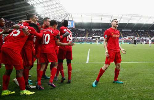 SWANSEA, WALES - OCTOBER 01:  James Milner of Liverpool celebrates scoring his sides second goal during the Premier League match between Swansea City and Liverpool at Liberty Stadium on October 1, 2016 in Swansea, Wales.  (Photo by Julian Finney/Getty Images)