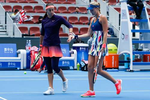 BEIJING, CHINA - OCTOBER 09:  Caroline Garcia of France and Kristina Mladenovic of France check hands against Bethanie Mattek-Sands of United States and Lucie Safarova of Czech Republic during the Womens doubles final on day nine of the 2016 China Open at the China National Tennis Centre on October 9, 2016 in Beijing, China.  (Photo by Etienne Oliveau/Getty Images)