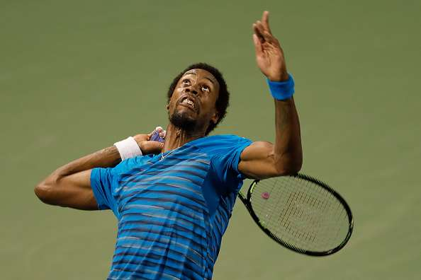 SHANGHAI, CHINA - OCTOBER 13:  Gael Monfils of France in action match against David Goffin of Belgium during the Men
