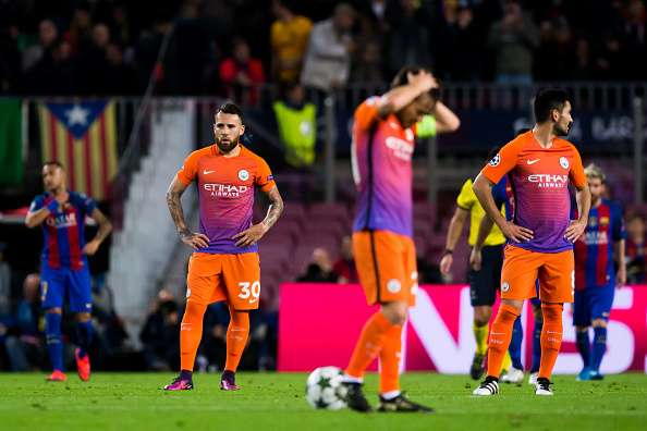 BARCELONA, SPAIN - OCTOBER 19: Nicolas Otamendi (L) and Ilkay Gundogan (R) of Manchester City FC look dejected after FC Barcelona scored a goal during the UEFA Champions League group C match between FC Barcelona and Manchester City FC at Camp Nou on October 19, 2016 in Barcelona, Spain. (Photo by Alex Caparros/Getty Images)