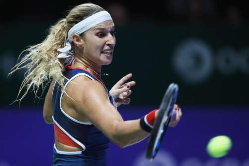 SINGAPORE - OCTOBER 23:  Dominika Cibulkova of Slovakia plays a forehand in her singles match against Angelique Kerber of Germany during day 1 of the BNP Paribas WTA Finals Singapore at Singapore Sports Hub on October 23, 2016 in Singapore.  (Photo by Matthew Stockman/Getty Images for WTA)
