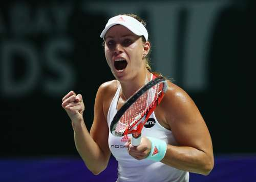 SINGAPORE - OCTOBER 23:  Angelique Kerber of Germany celebrates victory in her singles match against Dominika Cibulkova of Slovakia during day 1 of the BNP Paribas WTA Finals Singapore at Singapore Sports Hub on October 23, 2016 in Singapore.  (Photo by Clive Brunskill/Getty Images)