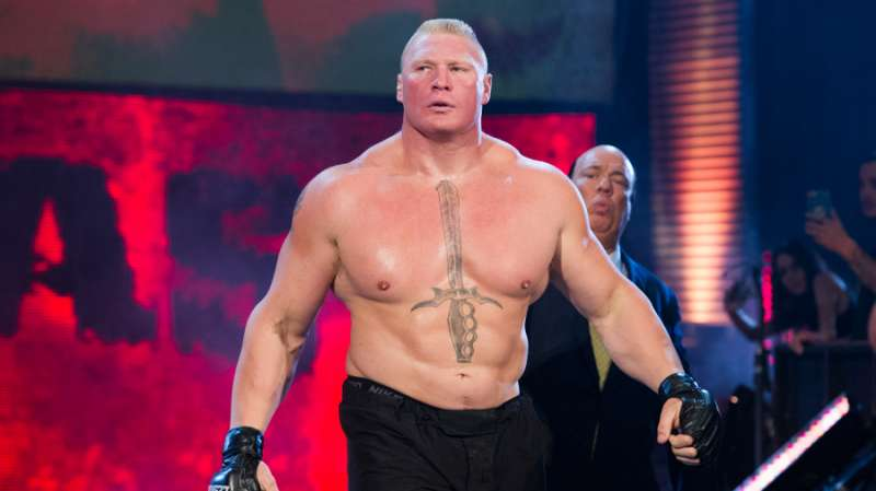 Brock Lesnar walks to the ring with his manager Paul Heyman