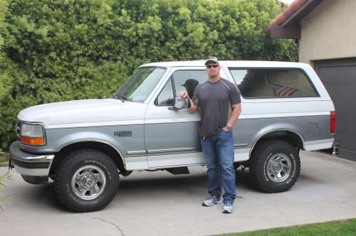 Austin posing with his 1995 Ford Bronco