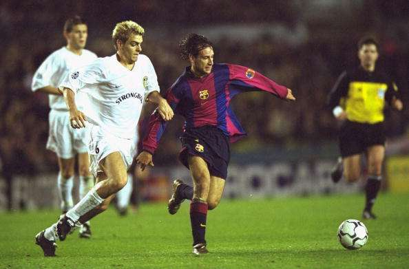 24 Oct 2000:  Alfonso of Barcelona holds off Jonathan Woodgate of Leeds United during the UEFA Champions League match played at Elland Road, in Leeds, England. The match ended in a 1-1 draw. \ Mandatory Credit: Shaun Botterill /Allsport