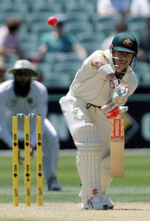 Cricket - Australia v South Africa - Third Test cricket match - Adelaide Oval, Adelaide, Australia - 25/11/16. Australia's David Warner blocks the ball during the second day of the Third Test cricket match in Adelaide. REUTERS/Jason Reed