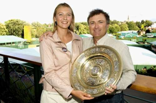 LONDON - JULY 3: Maria Sharapova of Russia, winner of the ladies singles finals, poses for a picture with her father, Yuri Sharapova as she holds the winning trophy on the 'Members Balcony' of the AELTC at the Wimbledon Lawn Tennis Championship on July 3, 2004 at the All England Lawn Tennis and Croquet Club in London. (Photo by Bob Martin/AELTC/POOL/Getty Images)
