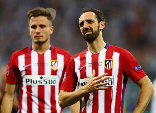 MILAN, ITALY - MAY 28:  Juanfran of Atletico Madrid shows his dejection during the UEFA Champions League Final match between Real Madrid and Club Atletico de Madrid at Stadio Giuseppe Meazza on May 28, 2016 in Milan, Italy.  (Photo by Clive Rose/Getty Images)