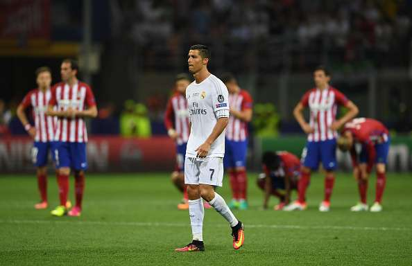 MILAN, ITALY - MAY 28:  Cristiano Ronaldo of Real Madrid steps up to take the final penalty during the UEFA Champions League Final match between Real Madrid and Club Atletico de Madrid at Stadio Giuseppe Meazza on May 28, 2016 in Milan, Italy.  (Photo by Laurence Griffiths/Getty Images)