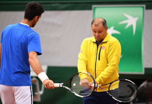 PARIS, FRANCE - JUNE 04:  Novak Djokovic of Serbia speaks with coach Marian Vajda during a training session on day fourteen of the 2016 French Open at Roland Garros on June 4, 2016 in Paris, France.  (Photo by Dennis Grombkowski/Getty Images)