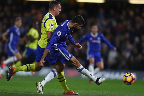 LONDON, ENGLAND - NOVEMBER 05: Diego Costa of Chelsea (R) shoots while under pressure from Phil Jagielka of Everton (L) during the Premier League match between Chelsea and Everton at Stamford Bridge on November 5, 2016 in London, England.  (Photo by Clive Rose/Getty Images)