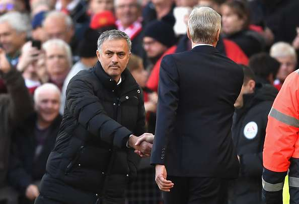 MANCHESTER, ENGLAND - NOVEMBER 19:  Jose Mourinho, Manager of Manchester United (L) and Arsene Wenger, Manager of Arsenal (R) shake hands prior to kick off during the Premier League match between Manchester United and Arsenal at Old Trafford on November 19, 2016 in Manchester, England.  (Photo by Shaun Botterill/Getty Images)