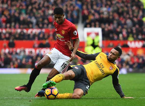 MANCHESTER, ENGLAND - NOVEMBER 19:  Marcus Rashford of Manchester United (L) is tackled by Francis Coquelin of Arsenal (R) during the Premier League match between Manchester United and Arsenal at Old Trafford on November 19, 2016 in Manchester, England.  (Photo by Shaun Botterill/Getty Images)