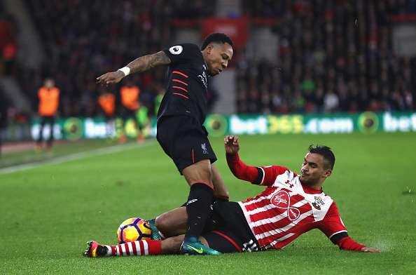 SOUTHAMPTON, ENGLAND - NOVEMBER 19: Nathaniel Clyne of Liverpool (L) is tackled by Sofiane Boufal of Southampton (R) during the Premier League match between Southampton and Liverpool at St Mary