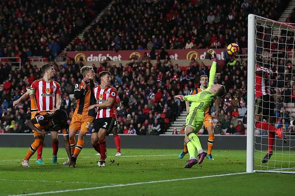 SUNDERLAND, ENGLAND - NOVEMBER 19: Jordan Pickford of Sunderland saves a header from Dieumerci Mbokani of Hull City during the Barclays Premier League match between Sunderland and Hull City at the Stadium of Light on November 19, 2016 in Sunderland, England. (Photo by Chris Brunskill/Getty Images)