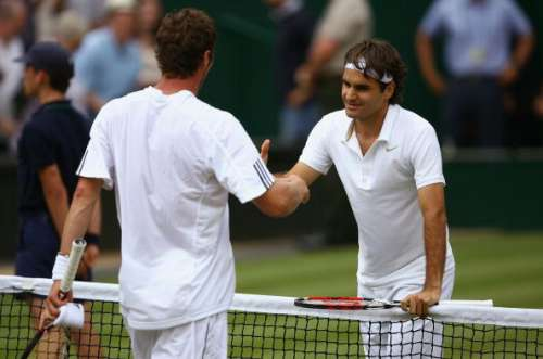 LONDON - JULY 04:  Roger Federer of Switzerland is congratulated on winning the men's singles Semi Final match by Marat Safin of Russia on day eleven of the Wimbledon Lawn Tennis Championships at the All England Lawn Tennis and Croquet Club on July 4, 2008 in London, England.  (Photo by Clive Brunskill/Getty Images)
