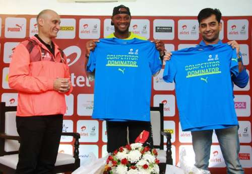 At the Airtel Delhi Half Marathon 2016 Finishers Tee unveiling picture (L to R),  Vivek Singh, Jt. MD, Procam International, Jamaican Sprinter & Sub 10 King Asafa Powell & Abhishek Ganguly, MD, Puma-India finishers tea ADHM 2016 Expo