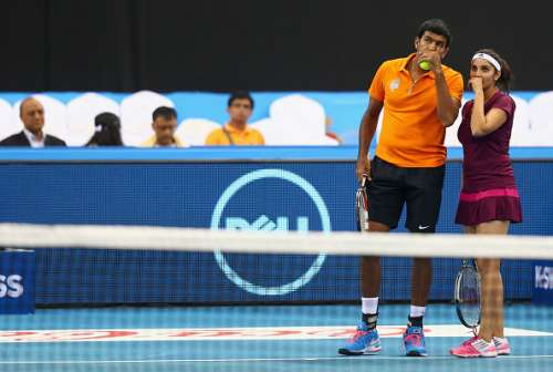 DUBAI, UNITED ARAB EMIRATES - DECEMBER 12:  Sania Mirza and Rohan Bopanna of the Indian Aces discuss tactics during their victory against Kirsten Flipkens and Daniel Nestor of the Manila Mavericks during the Coca-Cola International Premier Tennis League fourth leg at the Hamdan Sports Complex, December 12, 2014 in Dubai, .  (Photo by Clive Brunskill/Getty Images for IPTL 2014)
