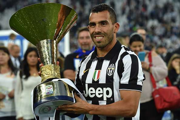 TURIN, ITALY - MAY 23:  Carlos Tevez of Juventus FC celebrates with the Serie A Trophy at the end of the Serie A match between Juventus FC and SSC Napoli at Juventus Arena on May 23, 2015 in Turin, Italy.  (Photo by Valerio Pennicino/Getty Images)