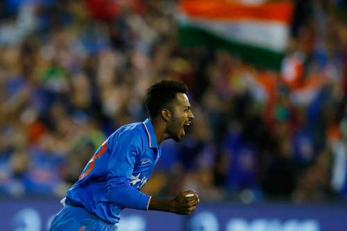 MELBOURNE, AUSTRALIA - JANUARY 29:  Hardik Pandya celebrates after taking a catch to dismiss Shaun Marsh during the International Twenty20 match between Australia and India at Melbourne Cricket Ground on January 29, 2016 in Melbourne, Australia.  (Photo by Zak Kaczmarek/Getty Images)