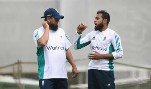 MANCHESTER, ENGLAND - JULY 21:  England bowler Adil Rashid (r) chats with spin bowling coach Saqlain Mushtaq during England Nets ahead of the 2nd Investec test match against Pakistan at Old Trafford on July 21, 2016 in Manchester, England.  (Photo by Stu Forster/Getty Images)