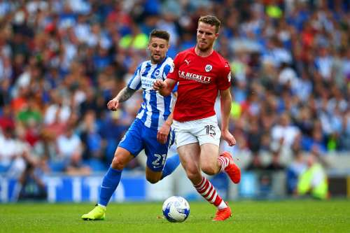 BRIGHTON, ENGLAND - SEPTEMBER 24:  Marley Watkins of Barnsley runs with the ball under pressure from Oliver Norwood of Brighton & Hove Albion during the Sky Bet Championship match between Brighton & Hove Albion and Barnsley at Amex Stadium on September 24, 2016 in Brighton, England.  (Photo by Dan Istitene/Getty Images)