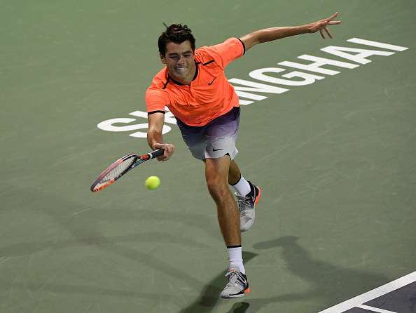SHANGHAI, CHINA - OCTOBER 12:  Taylor Fritz of United States returns a shot to Roberto Bautista Agut of Spain in the Men