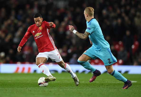 MANCHESTER, ENGLAND - NOVEMBER 24:  Memphis Depay of Manchester United is watched by Rick Karsdorp of Feyenoord during the UEFA Europa League Group A match between Manchester United FC and Feyenoord at Old Trafford on November 24, 2016 in Manchester, England.  (Photo by Gareth Copley/Getty Images)