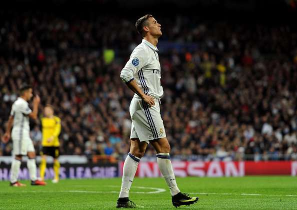 MADRID, SPAIN - DECEMBER 07:  Cristiano Ronaldo of Real Madrid reacts during the UEFA Champions League Group F match between Real Madrid CF and Borussia Dortmund at the Bernabeu on December 7, 2016 in Madrid, Spain.  (Photo by Denis Doyle/Getty Images)